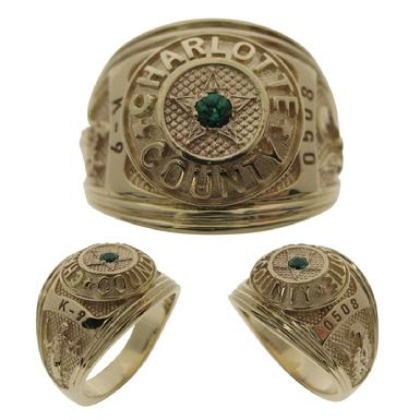 Custom Charlotte County (FL) Sheriff's Deputy class style ring in 10k yellow gold with lab created emerald center stone.