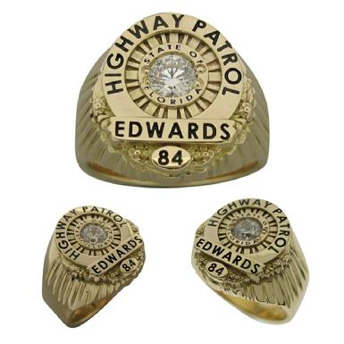 Custom Florida Highway Patrol Trooper badge ring in 14k gold with grooved side channels, black enamel, and a faceted center stone.